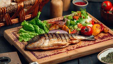 تفسير حلم أكل السمك المقلي مع الميت