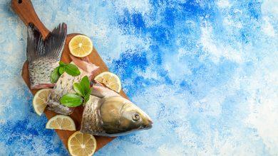 تنظيف السمك النيء في الحلم للمتزوجة
